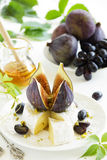 Appetizer of figs and brie cheese Royalty Free Stock Photos