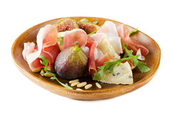 Appetizer with figs, cheese and ham Royalty Free Stock Photos