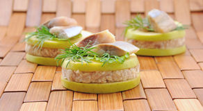 Appetizer of foie herring Stock Images