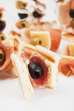 Appetizer food with salami and black olive Stock Photos