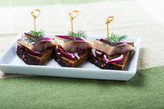 Appetizer food, sandwich with herring Royalty Free Stock Photography