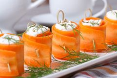 Appetizer of fresh carrot rolls with cream cheese Stock Images