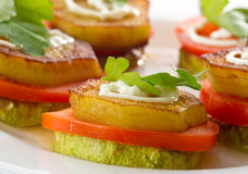 Appetizer of fried zucchini, eggplant and tomato Stock Image