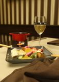 Appetizer with fruits,chocolate and wine. On a table in restaurant Stock Photo