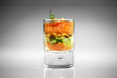 Appetizer in glass with salmon royalty free stock image