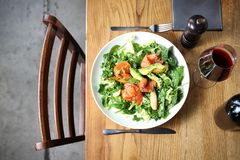 Appetizer. Green salad with spinach and rocket leaves with salmon, avocado and pear stock photos