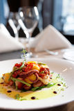 Appetizer with grilled octopus, potatoes and vegetables Stock Images
