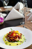 Appetizer with grilled octopus, potatoes and vegetables Royalty Free Stock Photography