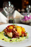 Appetizer with grilled octopus, potatoes and vegetables Royalty Free Stock Image