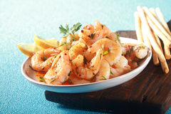 Appetizer of grilled pink prawns or shrimp Stock Photo