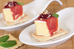 Appetizer with ham and cheese. Decorated with jam Stock Photos