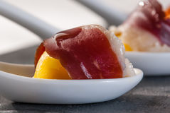 Appetizer ham and egg in porcelain spoon Stock Images