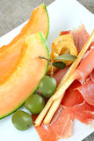 Appetizer ham and melon Stock Image
