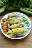 Appetizer of herring, boiled potatoes, pickled mushrooms Royalty Free Stock Image