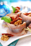 Appetizer of herring rolls with dried tomato and walnuts for chr Royalty Free Stock Images