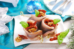 Appetizer of herring rolls with dried tomato and walnuts for chr Royalty Free Stock Image
