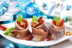 Appetizer of herring rolls with dried tomato and walnuts for chr Stock Photo