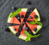 Appetizer of juicy watermelon, ripe blackberry and Royalty Free Stock Photos