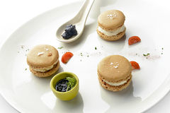 Appetizer Macarons with Foie Gras Ice Cream and Jam 1. Appetizer Macarons with Foie Gras Ice Cream and Jam in white plate Royalty Free Stock Images