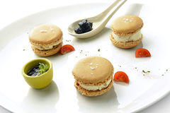 Appetizer Macarons with Foie Gras Ice Cream and Jam. In white plate Royalty Free Stock Image