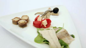 Appetizer of marinated fish with cheese and pepper. Closeup. Dolly shot stock video