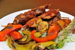 Appetizer meat kebab with vegetables Stock Photo