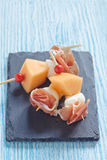 Appetizer with melon, cheese and ham Stock Photo