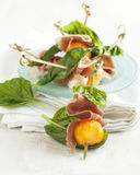 Appetizer with melon and prosciutto. Royalty Free Stock Photos