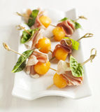 Appetizer with melon and prosciutto Stock Photo