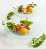 Appetizer with melon and prosciutto. Stock Photos