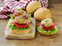 Appetizer mini burgers  tomatoes, lettuce and meat balls Royalty Free Stock Photos