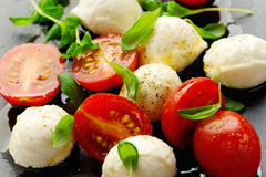 Appetizer with mozzarella cheese and cherry tomatoes Stock Photography