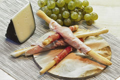 Appetizer with Parma ham on breadstick Stock Image
