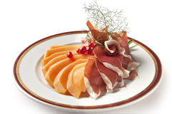 Appetizer Parma ham and melon with currants Stock Photos
