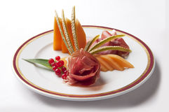 Appetizer Parma ham and melon with currants Royalty Free Stock Image