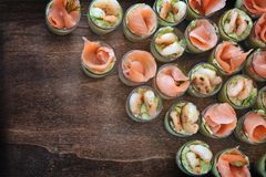 Appetizer on the party buffet appetizervwith salmon and prawn sh stock image