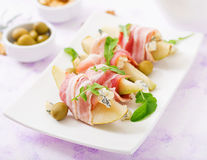 Appetizer with pear, blue cheese, prosciutto ham and toast for holidays. On a white plate Royalty Free Stock Image