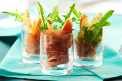 Appetizer with pear,prosciutto,arugula,gorgonzola. In glasses royalty free stock photography