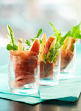 Appetizer with pear, prosciutto,arugula,gorgonzola. Appetizer with pear,prosciutto,arugula,gorgonzola in glasses royalty free stock image