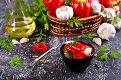 Appetizer of pickled red peppe. R with garlic and parsley. Selective focus Royalty Free Stock Image