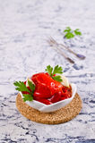 Appetizer of pickled red peppe. R with garlic and parsley. Selective focus Stock Photography