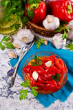 Appetizer of pickled red peppe. R with garlic and parsley. Selective focus Royalty Free Stock Photos