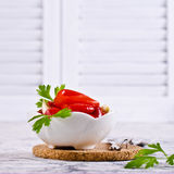 Appetizer of pickled red peppe. R with garlic and parsley. Selective focus Royalty Free Stock Photo