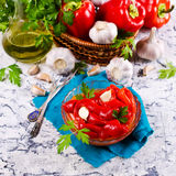 Appetizer of pickled red peppe. R with garlic and parsley. Selective focus Royalty Free Stock Photography