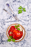 Appetizer of pickled red peppe. R with garlic and parsley. Selective focus Stock Images