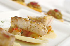 Appetizer: Piece of Fish on Vegetables Stock Photo