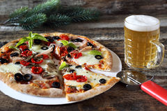 Appetizer: pizza and mug of lager beer Stock Photography