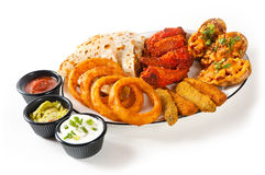 Appetizer plate. With dipping sauces on white Stock Image