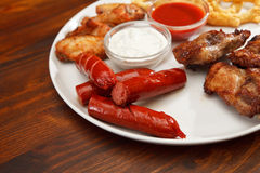 Appetizer plate. With dipping sauces Royalty Free Stock Image