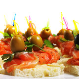 Appetizer Plate. Delicious Appetizer Plate with Salmon and Olives. Isolated on White Background Stock Images